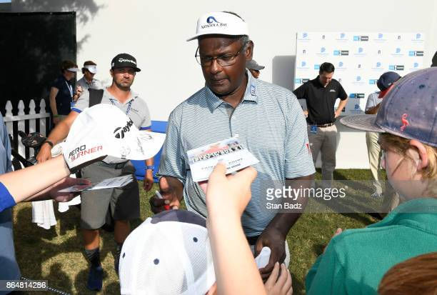 Vijay Singh signs autographs for fans after the second round of the PGA TOUR Champions Dominion Energy Charity Classic at The Country Club of...