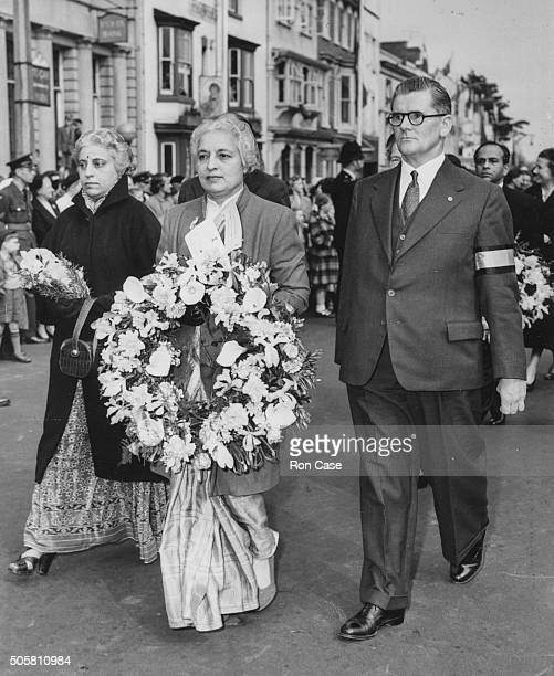 Vijaya Lakshmi Pandit Indian High Commissioner to London walking in a procession carrying a wreath after the flag ceremony at a celebration of the...