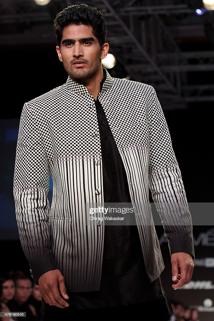 <a gi-track='captionPersonalityLinkClicked' href=/galleries/search?phrase=Vijender+Singh&family=editorial&specificpeople=4696246 ng-click='$event.stopPropagation()'>Vijender Singh</a> walks the runway wearing designs by Archana Kochar at Lakme Fashion Week Summer/Resort 2014 at the Grand Hyatt on March 16, 2014 in Mumbai, India.