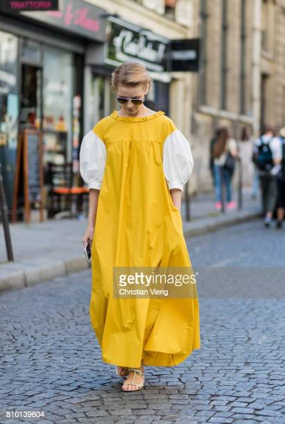 Vika Gazinskaya wearing a yellow dress outside Valentino during Paris Fashion Week Haute Couture Fall/Winter 20172018 Day Four on July 5 2017 in...
