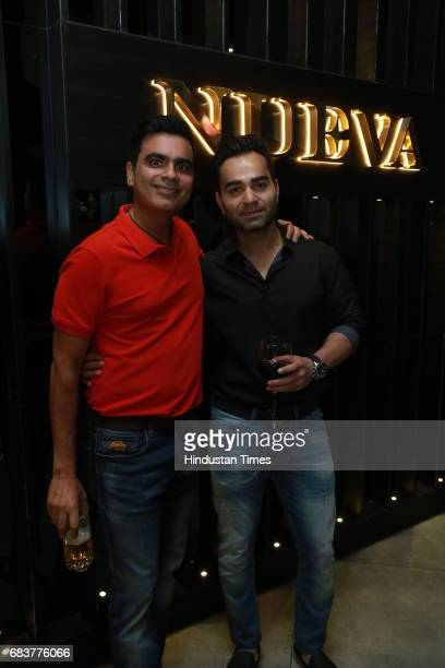 Vikas Kohli brother of Virat Kohli with Vikrant Batra during special dinner for Royal Challengers Bangalore teammates by Virat Kohli at his new...