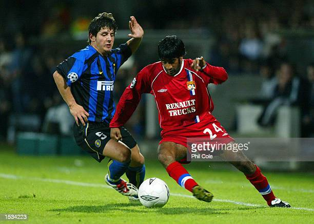 Vikash Dhorasoo of Lyon takes on Emre of Inter Milan during the UEFA Champions League First Phase Group D match between Lyon and Inter Milan at the...