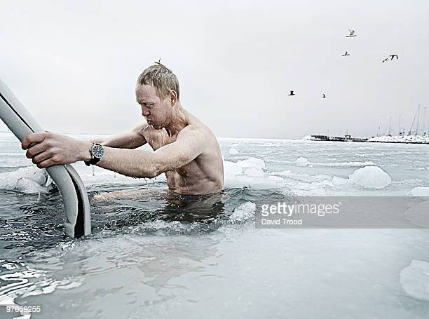 Viking man bathing in a hole in the icy sea.