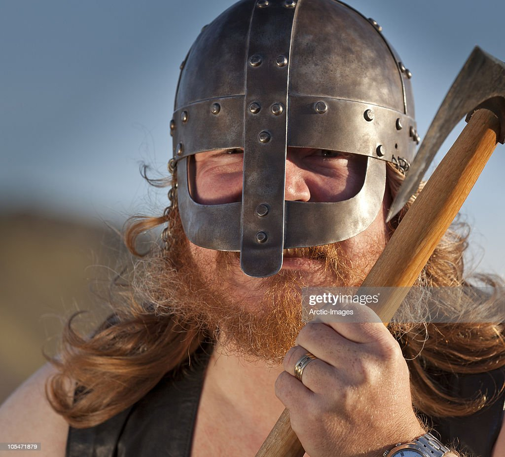 Viking Portrait with helmet and weapon : Stock Photo