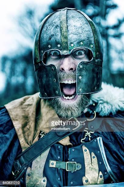 Viking warrior with helmet screams