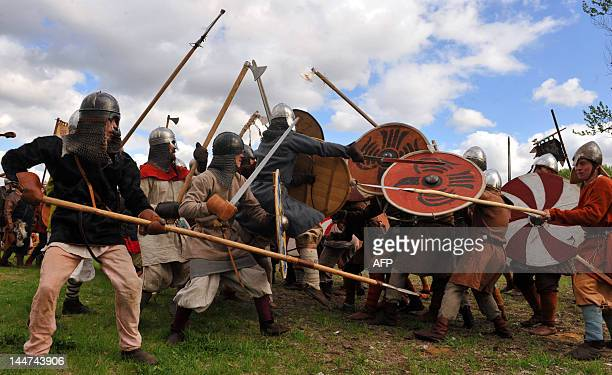 Vikingera reenactors take part in a staged battle during an annual festival 'Legend of the Norwegian Vikings' in the Peter and Paul fortress in...