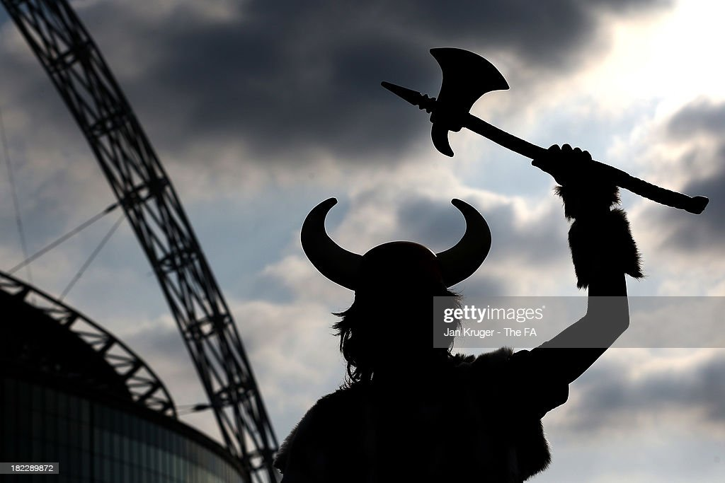 A Vikings fan poses ahead of the NFL International Series game between Minnesota Vikings and Pittsburgh Steelers at Wembley Stadium on September 29, 2013 in London, England.