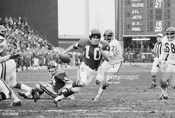 Vikings' Fran Tarkenton charges across the goal line here for a touchdown as Bears' Tony McGee can't reach him during the 3rd quarter of the...