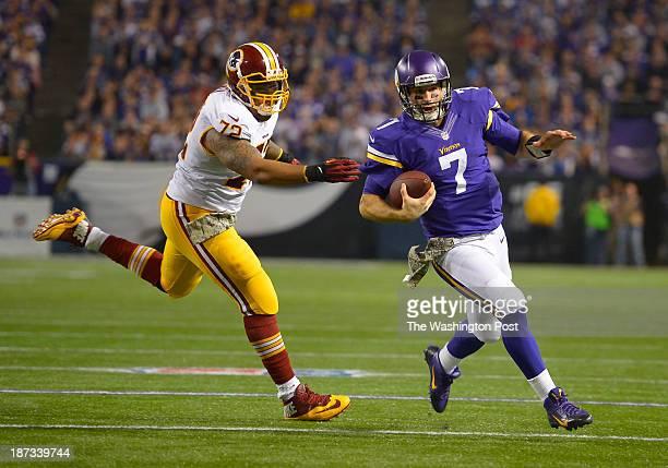 Vikings quarterback Christian Ponder runs past the reach of Washington defensive end Stephen Bowen during the third quarter of the Washington...