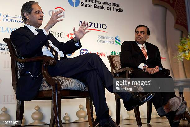 Vikram Pandit chief executive officer of Citigroup Inc left speaks while Mukesh D Ambani chairman of Reliance Industries Ltd listens at the Institute...