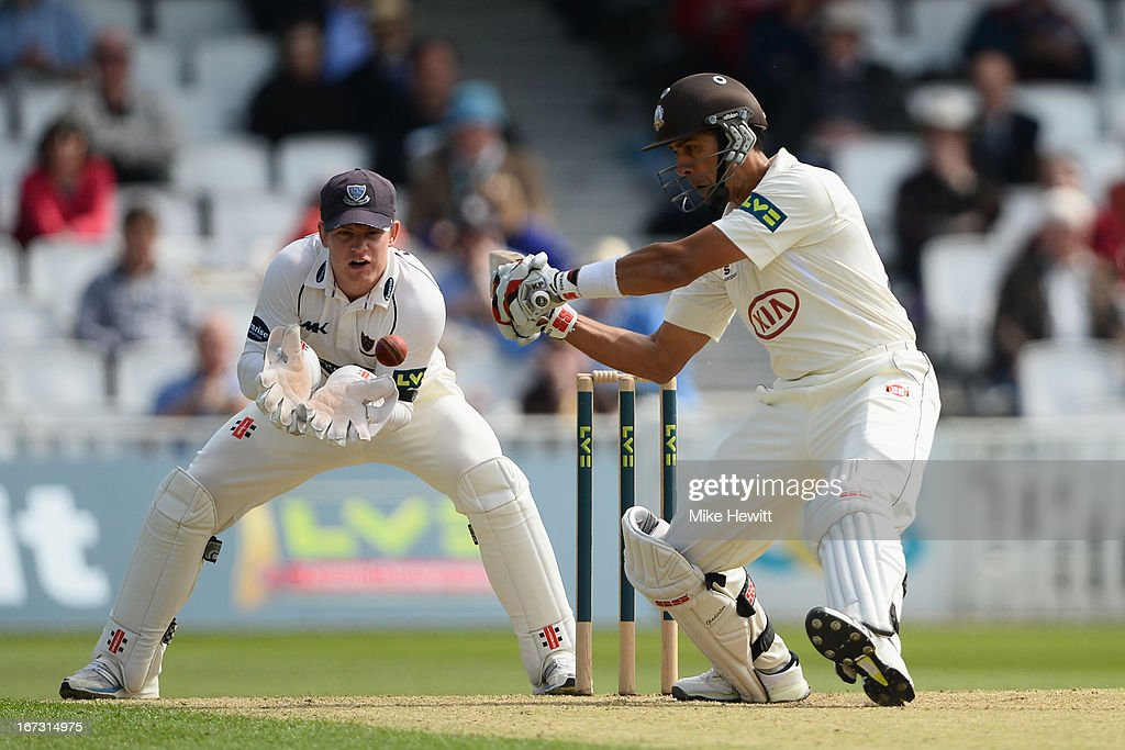 <a gi-track='captionPersonalityLinkClicked' href=/galleries/search?phrase=Vikram+Solanki&family=editorial&specificpeople=206814 ng-click='$event.stopPropagation()'>Vikram Solanki</a> of Surrey cuts for four as wicketkeeper Ben Brown looks on during day one of the LV County Championship Division One match between Surrey and Sussex at The Kia Oval on April 24, 2013 in London, England.