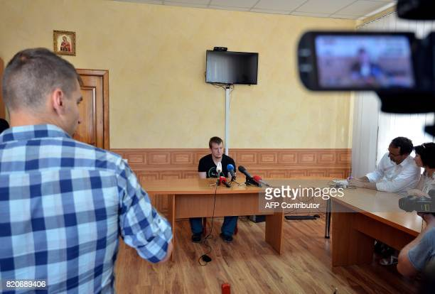 Viktor Ageyev a Russian detained in the wartorn Ukrainian east speaks to journalists as he is presented to the media during a meeting organised by...