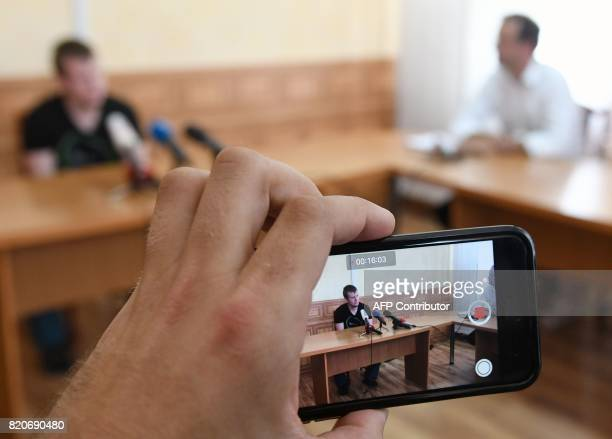 Viktor Ageyev a Russian detained in the wartorn Ukrainian east arrives to speak to journalists as he is presented to the media during a meeting...