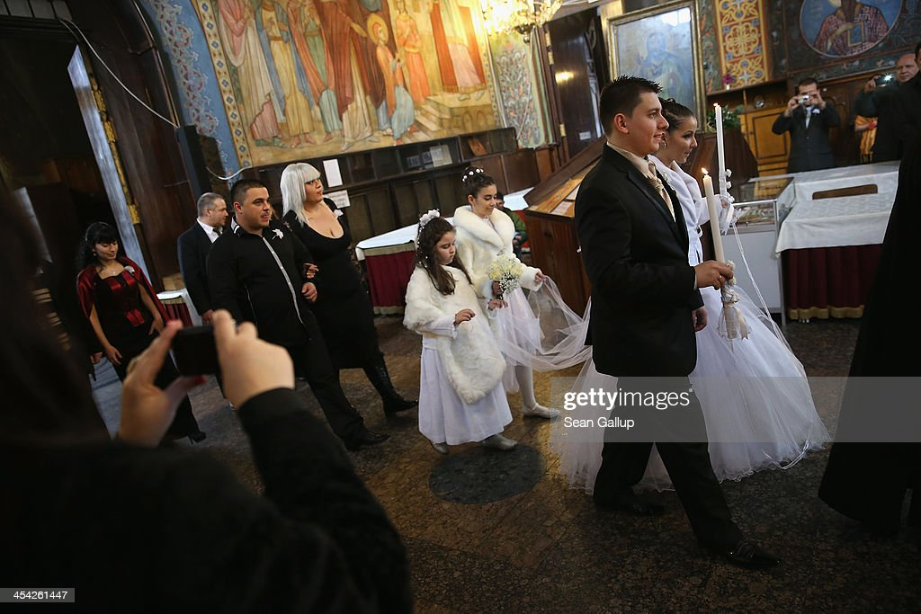 Viktor and Boriana wed at the St Nedelya Eastern Orthodox church on December 7, 2013 in Sofia, Bulgaria. Restrictions on the freedom of Bulgarians and Romanians to work in the European Union are due to run out by December 31, though several EU leaders, including British Prime Minister David Cameron, are considering imposing temporary restrictions to cut the flow of Romanians and Bulgarians arriving in EU countries. Many EU nations have voiced concern over too many Bulgarians and Romanians arriving and applying for social benefits. Romania and Bulgaria are both EU members though their citizens do not yet receive the same rights as citizens of other EU nations.