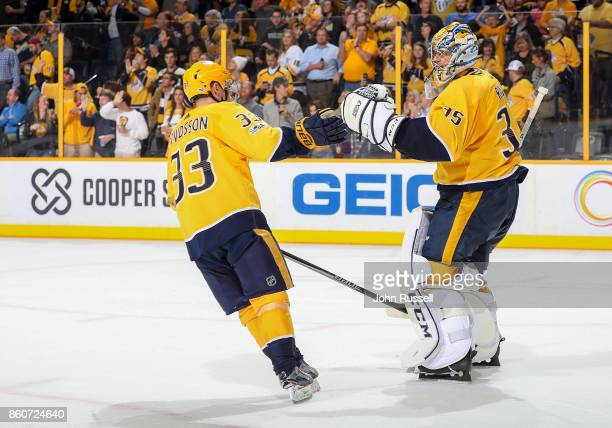Viktor Arvidsson congratulates Pekka Rinne of the Nashville Predators after a 41 win against the Dallas Stars during an NHL game at Bridgestone Arena...
