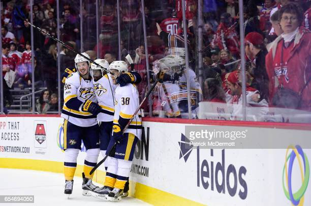 Viktor Arvidsson of the Nashville Predators celebrates his gamewinning goal in overtime with his teammates Ryan Johansen and PK Subban during an NHL...