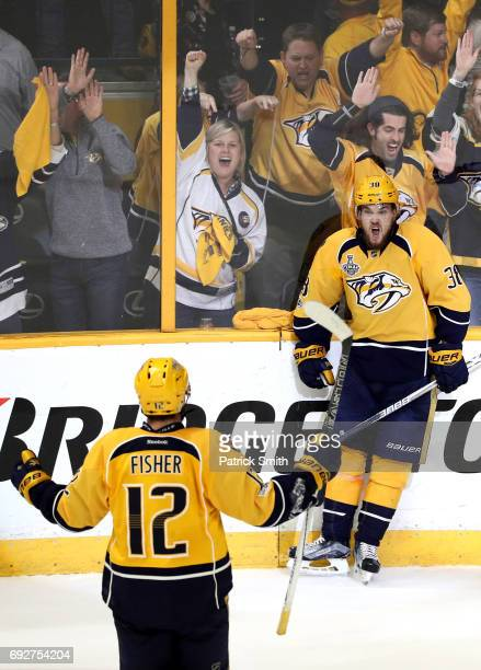 Viktor Arvidsson of the Nashville Predators celebrates with teammate Mike Fisher after scoring a goal on Matt Murray of the Pittsburgh Penguins...