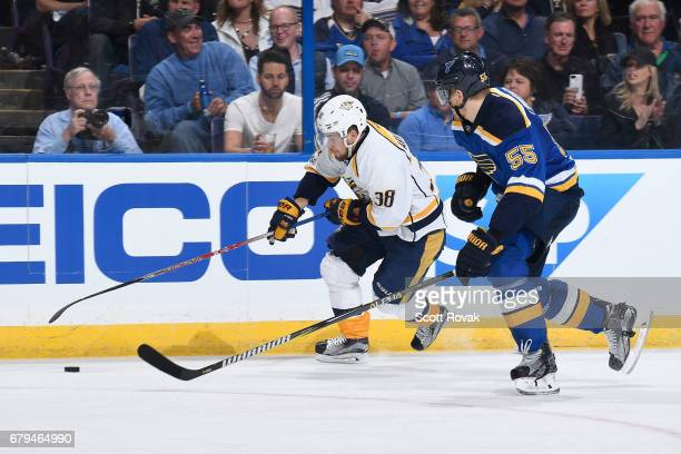 Viktor Arvidsson of the Nashville Predators controls the puck as Colton Parayko of the St Louis Blues defends in Game Five of the Western Conference...