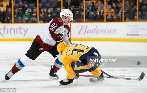 Viktor Arvidsson of the Nashville Predators defends against Gabriel Landeskog of the Colorado Avalanche during an NHL game at Bridgestone Arena on...