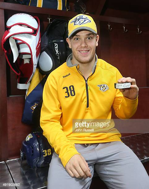 Viktor Arvidsson of the Nashville Predators holds the puck from his first NHL goal after an NHL game against the Carolina Hurricanes at Bridgestone...