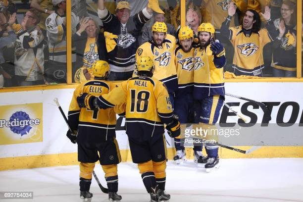 Viktor Arvidsson of the Nashville Predators is congratulated by his teammates after scoring a goal against the Pittsburgh Penguins during the second...