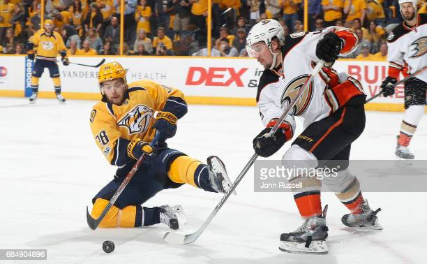 Viktor Arvidsson of the Nashville Predators loses his edge as he battles for the puck against Sami Vatanen of the Anaheim Ducks in Game Four of the...