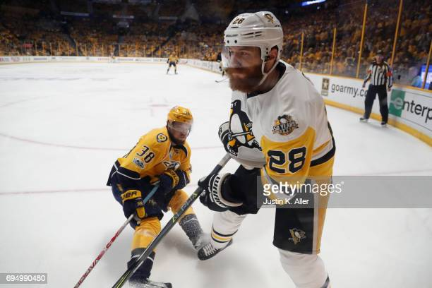 Viktor Arvidsson of the Nashville Predators skates against Ian Cole of the Pittsburgh Penguins during the first period in Game Six of the 2017 NHL...