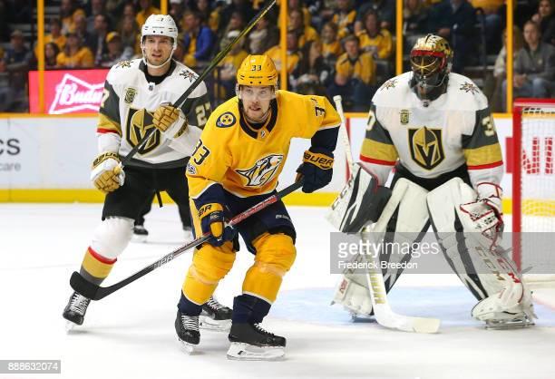 Viktor Arvidsson of the Nashville Predators skates against Shea Theodore of the Las Vegas Golden Knights during the first period at Bridgestone Arena...