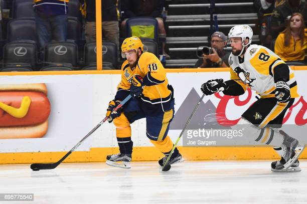 Viktor Arvidsson of the Nashville Predators skates the puck along the boards in the second period of Game Six of the 2017 NHL Stanley Cup Final at...