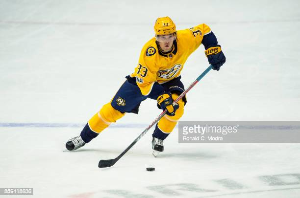 Viktor Arvidsson of the Nashville Predators skates with the puck during a NHL preseason game against the Tampa Bay Lightning at Bridgestone Arena on...