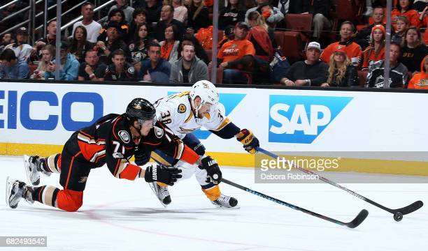 Viktor Arvidsson of the Nashville Predators skates with the puck against Brandon Montour of the Anaheim Ducks in Game One of the Western Conference...