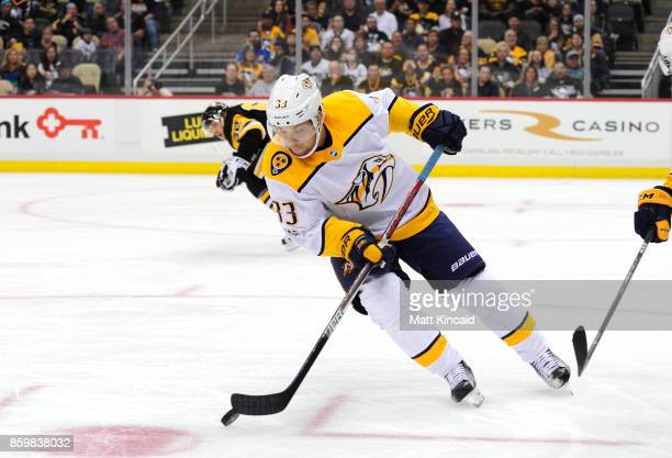 Viktor Arvidsson of the Nashville Predators skates with the puck against the Pittsburgh Penguins at PPG PAINTS Arena on October 7 2017 in Pittsburgh...