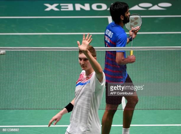Viktor Axelsen of Denmark celebrates his victory against Srikanth Kidambi of India during their men's singles quarterfinal match at the Japan Open...