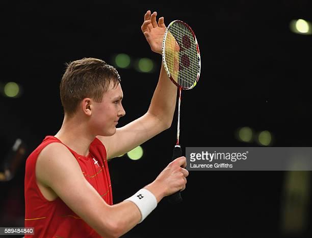 Viktor Axelsen of Denmark celebrates victory during his Badminton Mens Singles match againston Dong Keun Lee of Republic of Korea on Day 9 of the Rio...