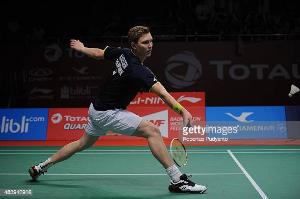 Viktor Axelsen of Denmark competes against Chen Long of China in the quarter finals match of the 2015 Total BWF World Championship at Istora Senayan...