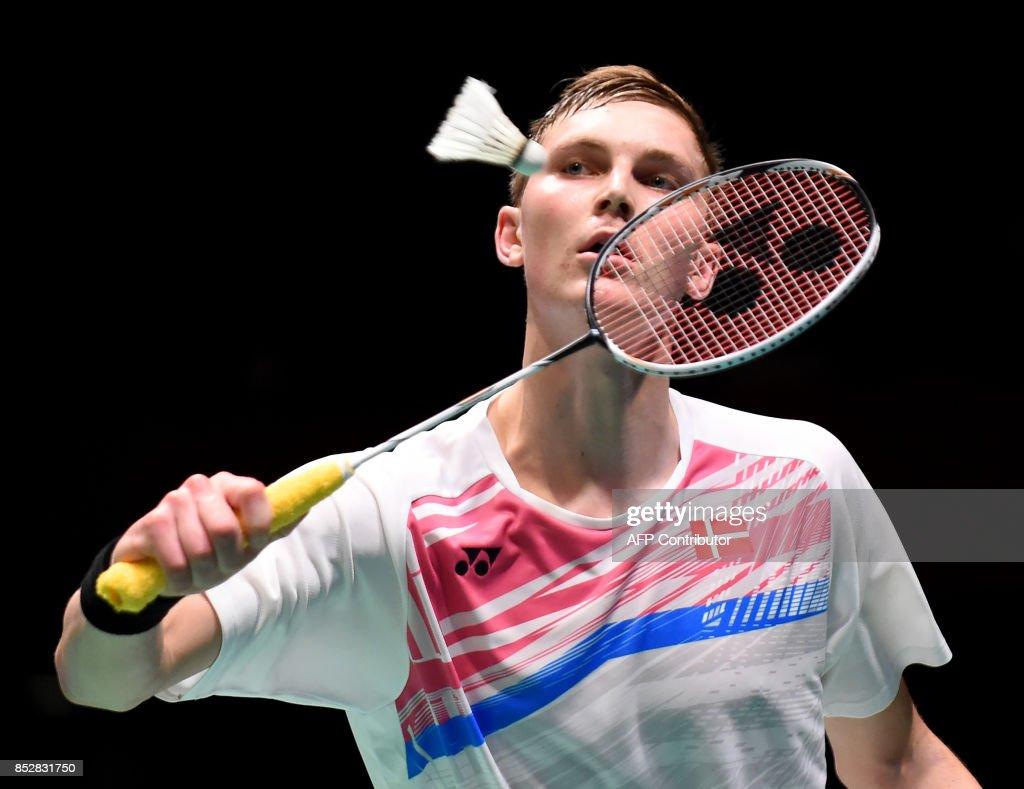 Viktor Axelsen of Denmark hits a return against Lee Chong Wei of