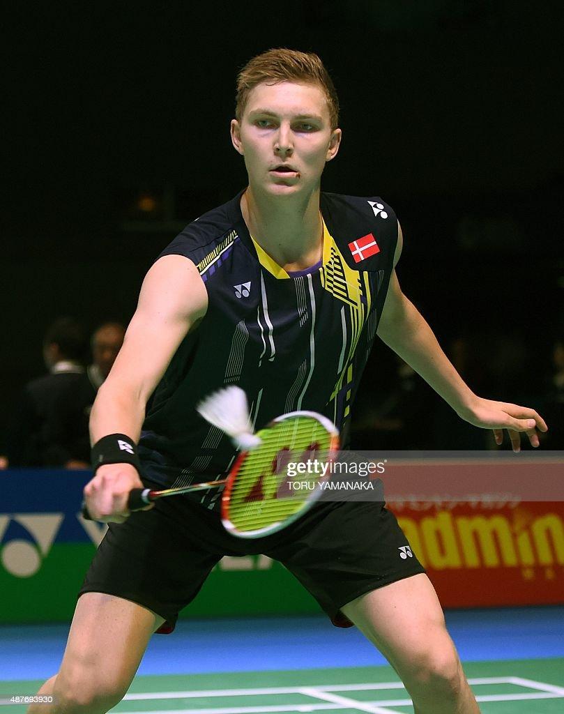 Viktor Axelsen of Denmark hits a return against Lee Dong Keun of