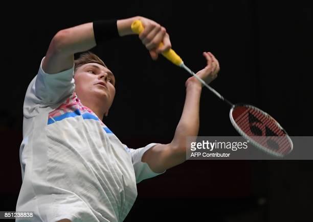 Viktor Axelsen of Denmark hits a return against Srikanth Kidambi of India during their men's singles quarterfinal match at the Japan Open Badminton...