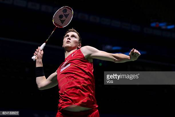 Viktor Axelsen of Denmark returns a shot against Takuma Ueda of Japan during men's singles quarterfinal match on day four of BWF Thaihot China Open...