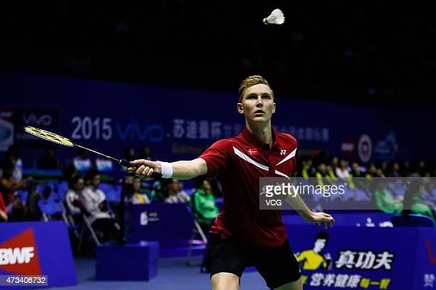 Viktor Axelsen of Denmark returns to Kento Momota of Japan during Men's Singles match on day six of 2015 Sudirman Cup BWF World Mixed Team...