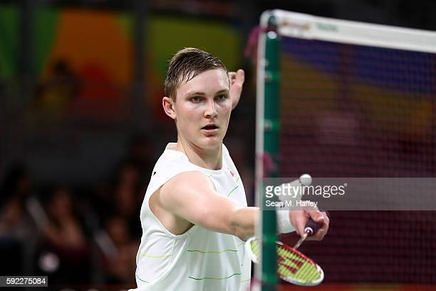 Viktor Axelson of Denmark competes against Dan Lin of China during the Men's Singles Badminton Bronze Medal match on Day 15 of the Rio 2016 Olympic...