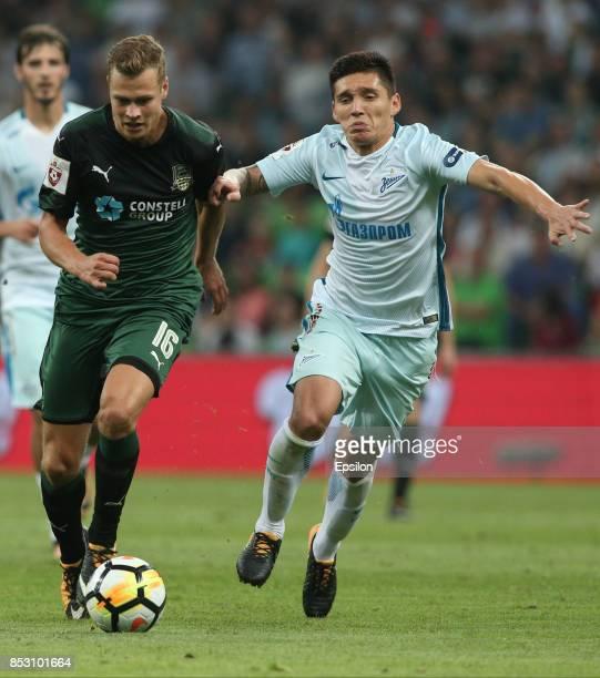 Viktor Claesson of FC Krasnodar is challenged by Matias Kranevitter of FC Zenit St Petersburg during the Russian Premier League match between FC...