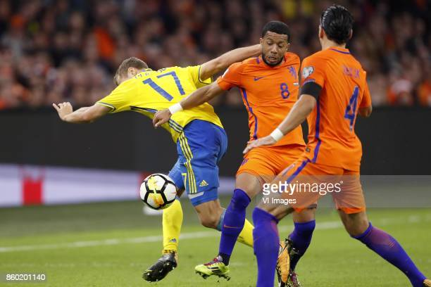 Viktor Claesson of Sweden Tonny Vilhena of Holland Karim Rekik of Holland during the FIFA World Cup 2018 qualifying match between The Netherlands and...