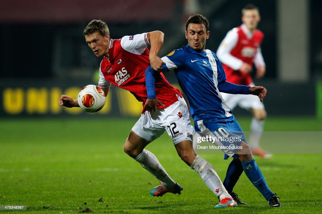 Viktor Elm of AZ is tackled by Serhiy Rybalka of Slovan Liberec during the UEFA Europa League Round of 32 match between AZ Alkmaar and FC Slovan...