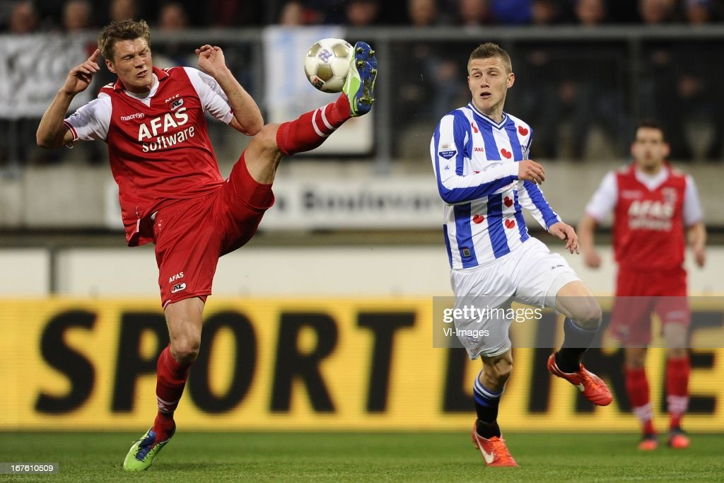 Viktor Elm of AZ, Jeffrey Gouweleeuw of sc Heerenveen, during the Dutch Eredivisie match between sc Heerenveen and AZ Alkmaar on April 26, 2013 at the Abe Lenstra stadium in Heerenveen, The Netherlands.