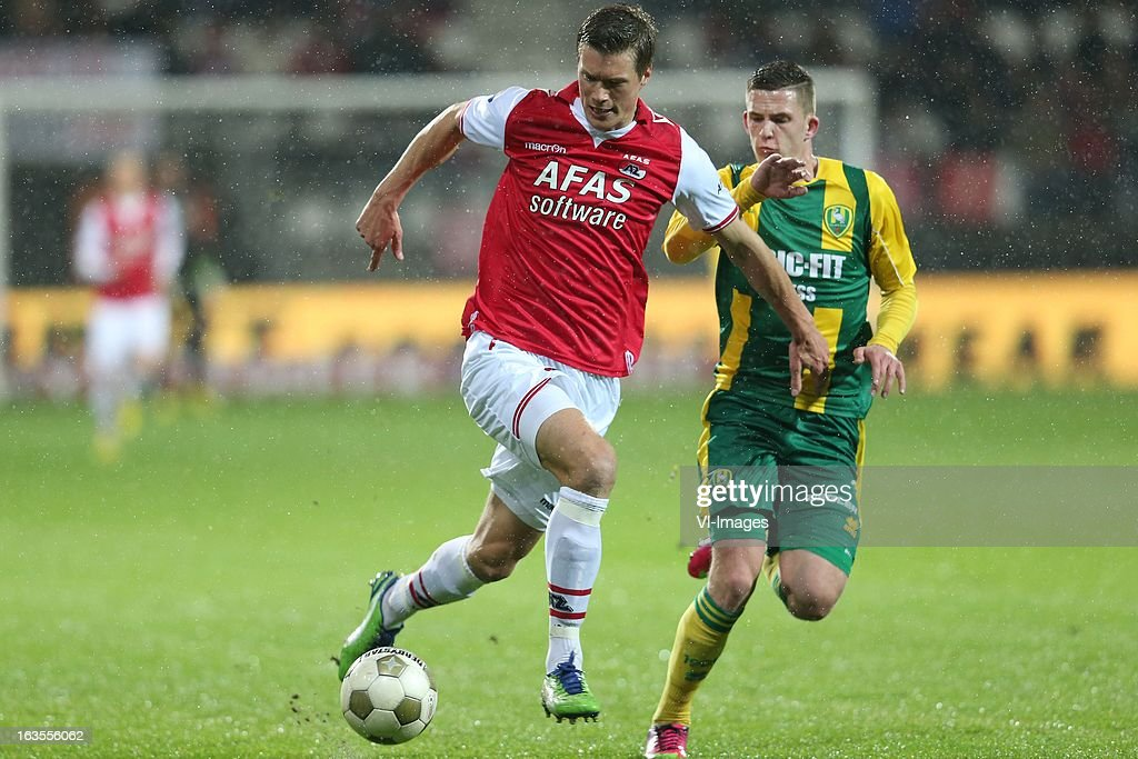 Viktor Elm of AZ, Kevin Jansen of ADO Den Haag during the Dutch Eredivisie match between AZ Alkmaar and ADO Den Haag at the AFAS Stadium on march 09, 2013 in Alkmaar, The Netherlands