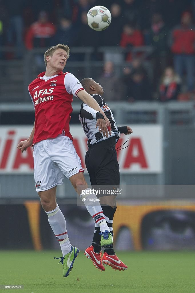 Viktor Elm of AZ, Lerin Duarte of Heracles Almelo during the Dutch Eredivisie match between Heracles Almelo and AZ Alkmaar at the Polman Stadium on march 31, 2013 in Almelo, The Netherlands