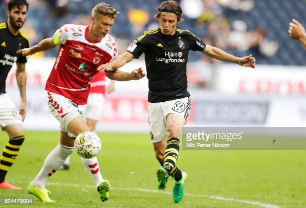 Viktor Elm of Kalmar FF and Kristoffer Olsson of AIK competes for the ball during the Allsvenskan match between AIK and Kalmar FF at Friends arena on...