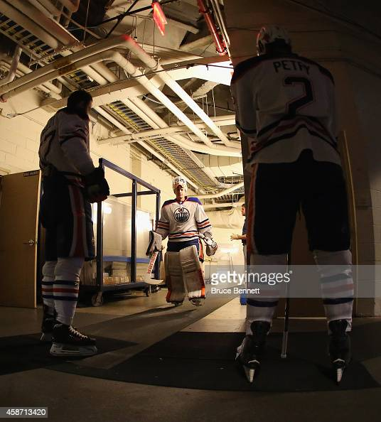 Viktor Fasth and the Edmonton Oilers walk out to the ice for warmups prior to the game against the New York Rangers at Madison Square Garden on...
