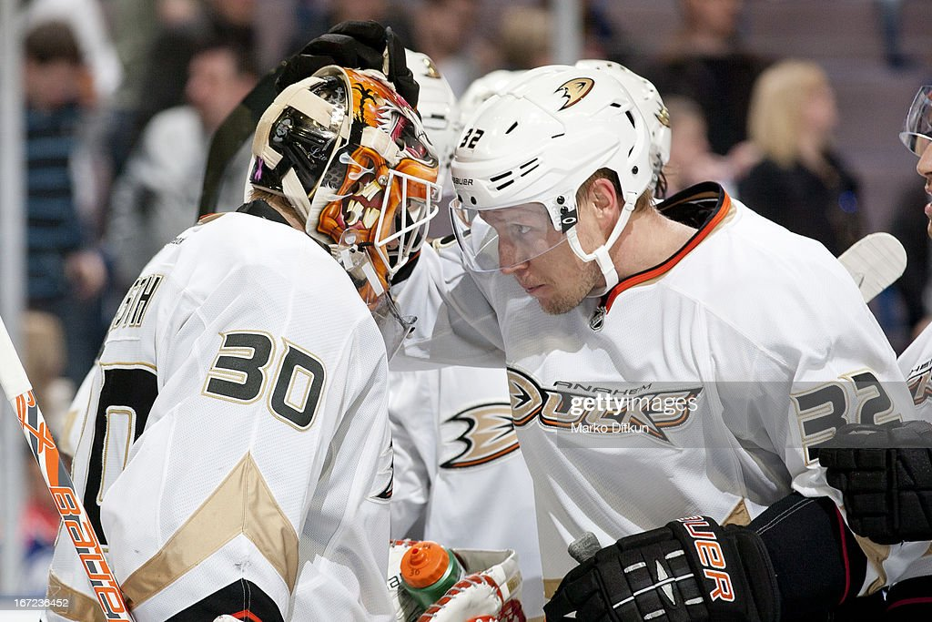 Viktor Fasth #30 and Toni Lydman #32 of the Anaheim Ducks celebrate after winning the game against the Edmonton Oilers on April 22, 2013 at Rexall Place in Edmonton, Alberta, Canada.